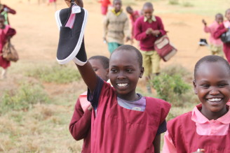"Christel Nani Adventures in Africa, ""Safari and Shoes."" Volunteers visited a school bringing much needed sneakers and art supplies and went game driving with world class guide, Jackson Looseyia, from the hit show, ""Big Cat Diaries""."